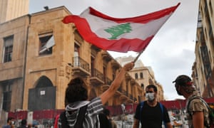 People hold a protest outside the offices of Lebanon's parliament on 10 August, the day prime minister Hassan Diab and his cabinet resigned.