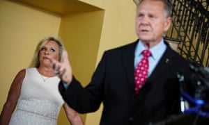 Roy Moore announces his candidacy at a news conference while his wife Kayla looks on.