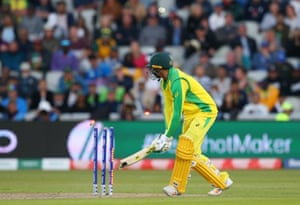 Usman Khawaja of Australia plays the ball on to his own wicket to be dismissed.