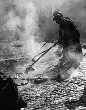 Asphalting wooden blocks in Charing Cross Road, c1935 by Wolfgang Suschitzky.