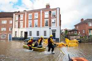Fire and Rescue officers use an inflatable raft to rescue a woman in Bewdley