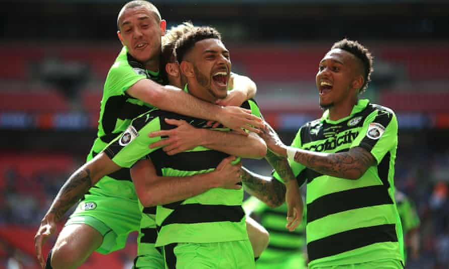 Kaiyne Woolery of Forest Green is congratulated by team-mates after scoring their third goal in the National League play-off final against Tranmere at Wembley