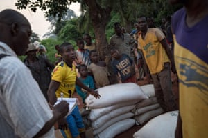 Displaced people from Gambo count bags of grain in Loungougba, in south-east Central African Republic