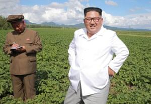 Samjiyon County, North Korea. Kim Jong-un inspects a farm