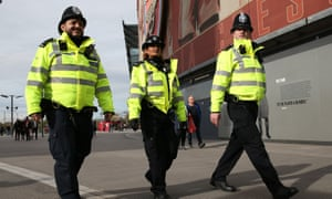 Police officers on duty in London. Ministers have rejected police complaints that the funding squeeze has been too severe.