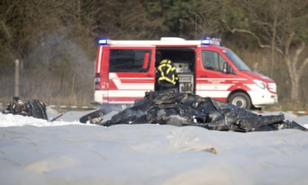 The burnt out debris of a small aircraft lies on a field near the small airport of Egelsbach