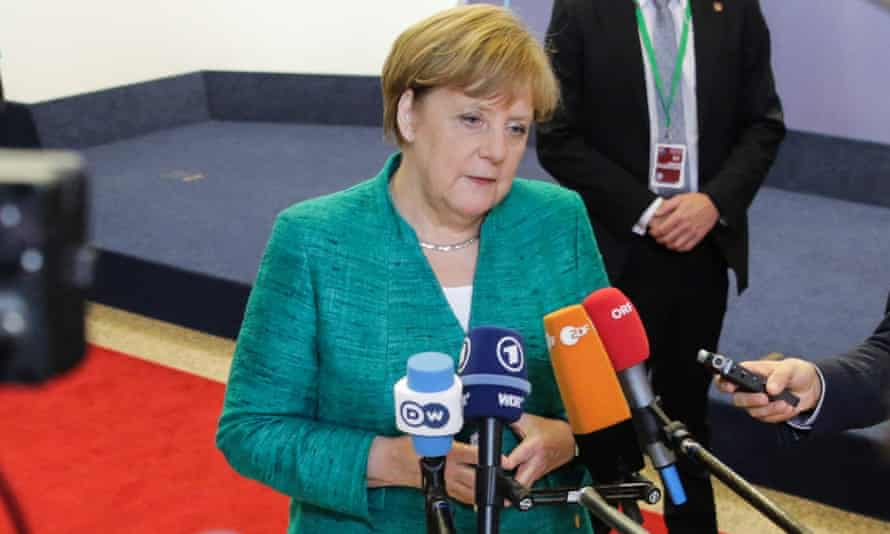 German chancellor Angela Merkel speaks to the press before leaving the first day of a European Union leaders' summit focused on migration, Brexit and eurozone reforms.