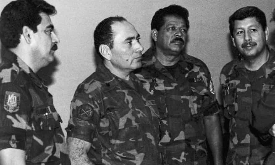 July 1989 photograph showing head of the joint chiefs of staff Colonel René Ponce (left), who died in 2011, and Col Inocente Orlando Montano (second from right), who is accused of being one of the crime's 'intellectual authors'.