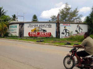 Signs on the main road of Nauru read 'drink, drive, go to jail'