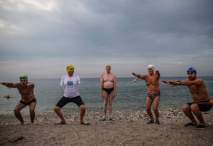 Istanbul, TurkeyEnglish channel swimmer Michael Read, centre, 79, warms up to swim with Istanbul's Avcılar municipality mayor, Turan Hançerli, second left, who is an amputee, and other Turkish swimmers in the Marmara sea. Michael Read will try to swim approximately 90km to Cyprus from Mersin, Turkey on 1 October