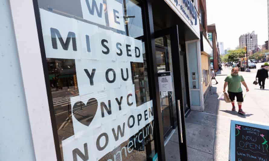 A person walks past a skincare store as more businesses reopen in New York City this month.