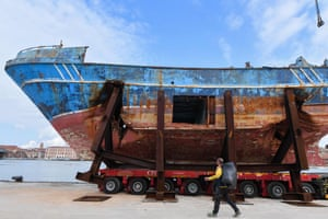 A fishing vessel that sank in 2015, trapping hundreds of migrants in its hull, is installed at Venice's former shipyard by artist Christoph Büchel, prior to the the 58th Venice Biennale.