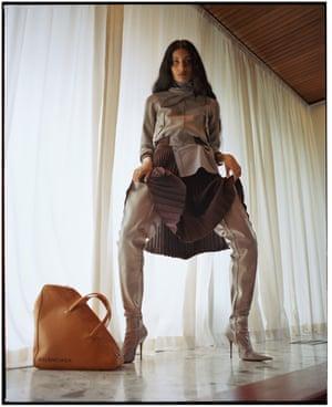 Jacket, £1,535, shirt, £675, skirt, £1,445, boots, £415, and bag, £395, all by Balenciaga.