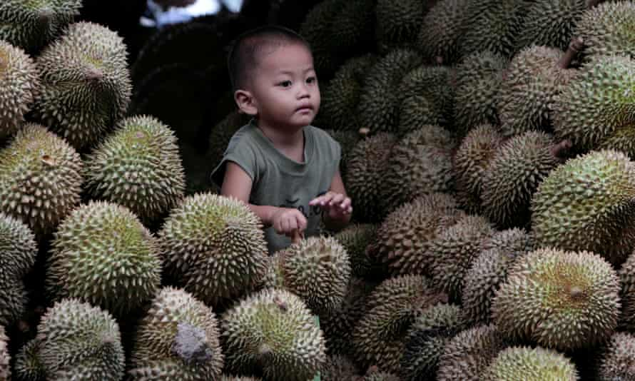 A boy at a durian market in Bangkok.