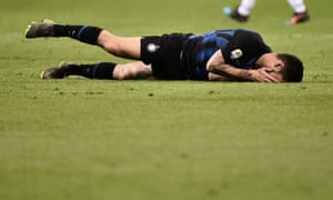 Inter midfielder Matteo Politano holds his face in his hands after defeat to Lazio.