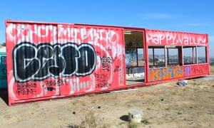 The windows are smashed, the walls are covered in graffiti, and the solar panels gone.