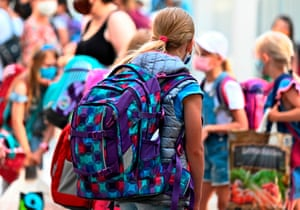 Pupils arrive for class at the Carl Orff primary school in west Berlin, as school resumes after the summer break.