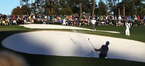 Martin Kaymer hits from a bunker on the 18th