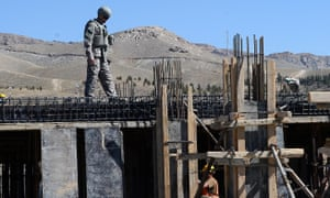 A project engineer with the US Army Corps of Engineers inspects construction work in Afghanistan