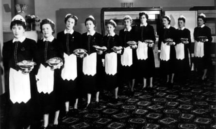 They also serve: a line of Nippies, Lyons Corner House waitresses, in 1930