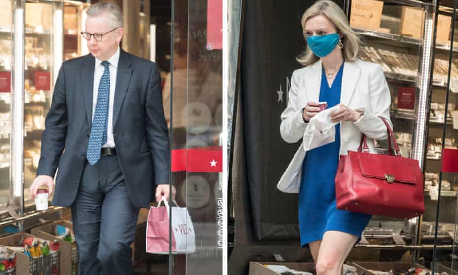Michael Gove without a mask and Liz Truss with a mask
