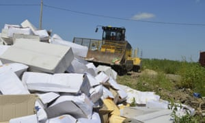 A bulldozer is used to destroy illegally imported food in Russia.