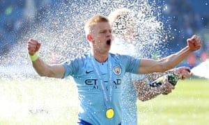 Oleksandr Zinchenko celebrates Premier League success at Brighton on Sunday, and is hoping to add the FA Cup at Wembley this Saturday.