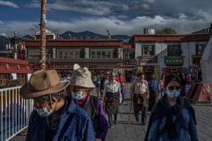 Tibetan Buddhists walk the kora in front the Jokhang Temple