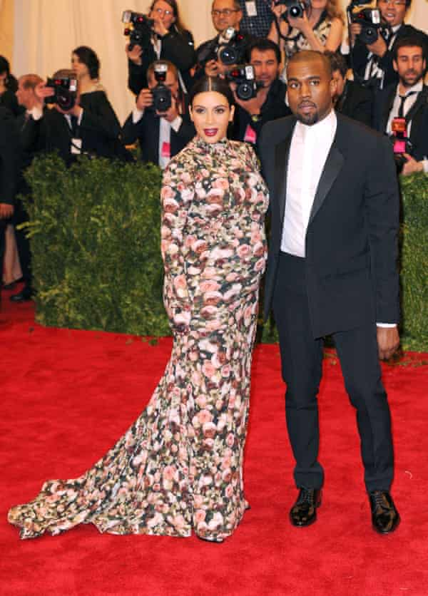 'Dressed as a sofa' ... seven months pregnant in Givenchy – with Kanye in 2013.