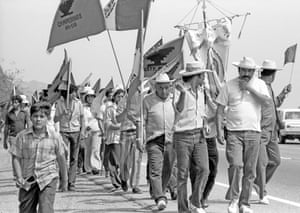 Labor activist Cesar Chavez leads the United Farm Worker's on a march in California's Central Valley, 1975.