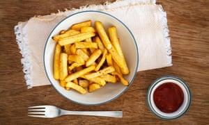 Bowl of fries and bowl of ketchup