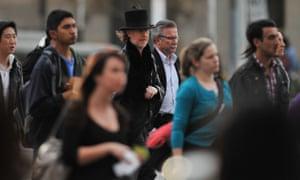 People walk on Flinders Street in Melbourne