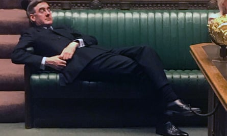 Jacob Rees-Mogg relaxing on the front benches
