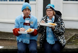 Manchester City fans tuck into some pre match fish and chips before the Manchester Derby at the Etihad Stadium.