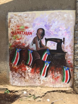 Street art depicting a child working at a sewing machine