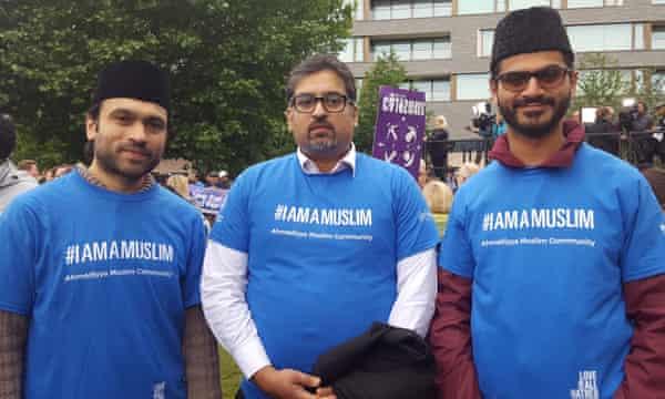 Three men in blue t-shirts