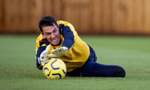 Lovre Kalinic dives to make a save during Aston Villa training.
