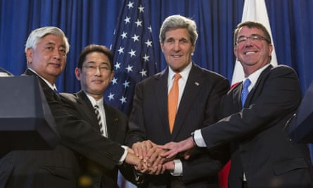 The Japanese defense and foreign ministers, Gen Nakatani and Fumio Kishida, seal a defense deal with the US secretaries of state and defense, John Kerry, and Ashton Carter.