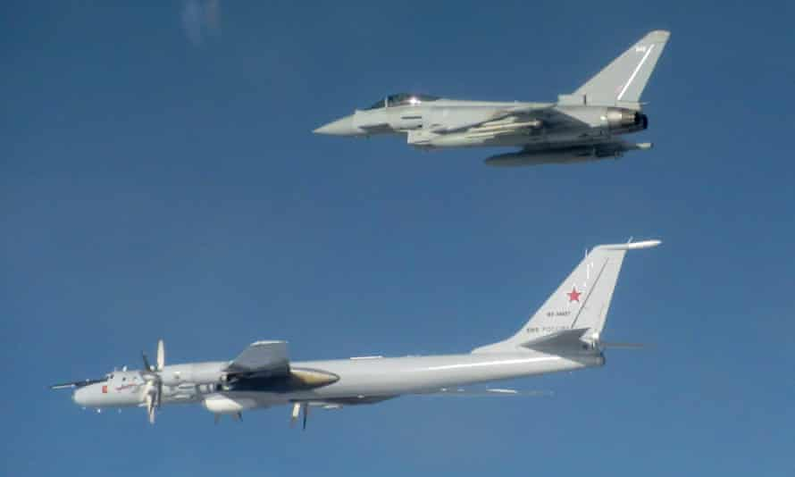 A Typhoon, top, with a Russian Tupolev Tu-142 aircraft.