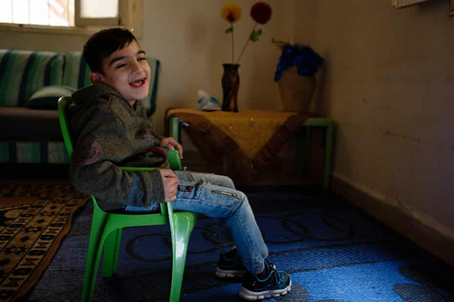 Ghazzi, who is eight years old and has cerebral palsy, in the apartment where he lives with his parents and six siblings in Beirut, Lebanon, 24 March 2021