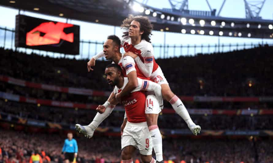 Alexandre Lacazette carries Pierre-Emerick Aubameyang and Matteo Guendouzi on his back after hitting back at Valencia during the Europa League semi-final first leg.