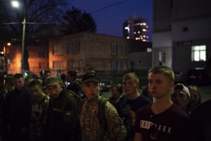 Members the youth wing of the nationalist Svoboda party stand in formation after a concert in Kiev