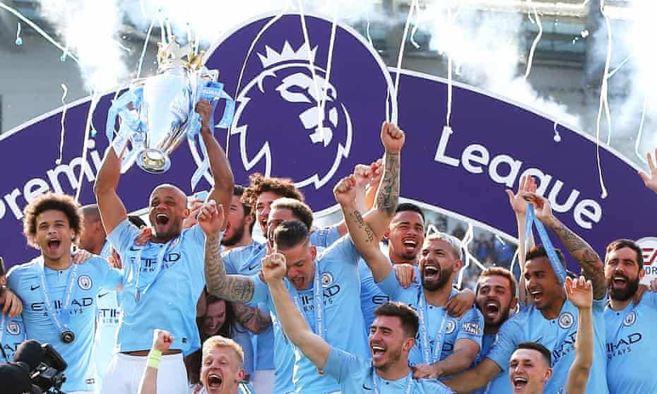 Manchester City players celebrate winning the 2019 Premier League.