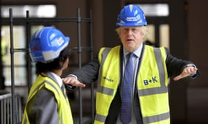 Boris Johnson talks with year 10 pupil Vedant Jitesh during a visit to the construction site of Ealing Fields High School in west London this morning.
