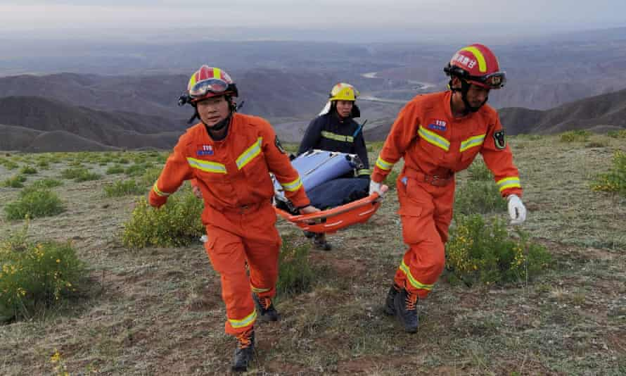 Rescuers search for missing runners after severe weather struck during a mountain race in Gansu, China.