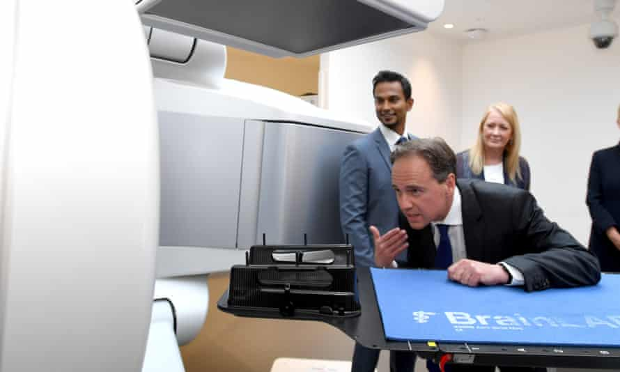 Greg Hunt inspects a cancer detection machine while on a tour of the Peter MacCallum Cancer Centre in December
