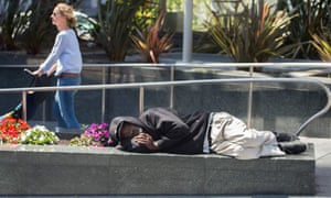 A homeless man sleeps in downtown San Francisco. There are roughly 2,000 people living on the city's streets.