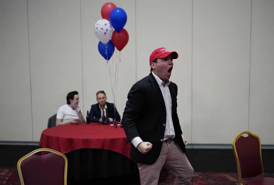 Donald Trump supporter John McGuinness celebrates while watching election returns in favor for Trump at a Republican election night watch party, Tuesday, Nov. 3, 2020, in Las Vegas.