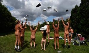 Nudists celebrating the creation of the Bois de Vincennes park in Paris on Thursday