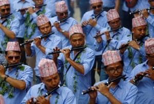 Devotees play flute during a parade commemorating the Neku Jatra-Mataya festival in  Lalitpur, Nepal